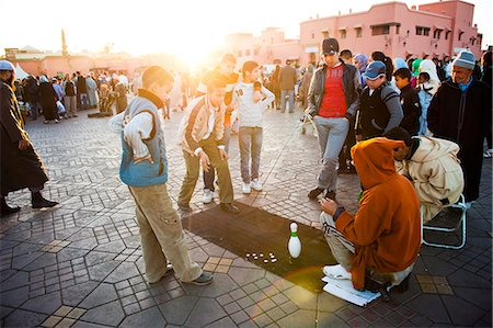 Moroccan people playing street games in Place Djemaa El Fna, the famous square in Marrakech, Morocco, North Africa, Africa Stock Photo - Rights-Managed, Code: 841-06804585