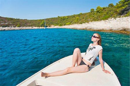 Tourist sunbathing on a boat in the Pakleni Islands (Paklinski Islands), Hvar Island, Dalmatian Coast, Adriatic Sea, Croatia, Europe Stock Photo - Rights-Managed, Code: 841-06804731