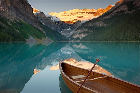 Canoe on Lake Louise at sunrise, Banff National Park, UNESCO World Heritage Site, Alberta, Rocky Mountains, Canada, North America Stock Photo - Rights-Managed, Code: 841-06805517
