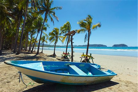Boat on the palm-fringed beach at this laid-back village & resort, Samara, Guanacaste Province, Nicoya Peninsula, Costa Rica, Central America Stock Photo - Rights-Managed, Code: 841-06807489