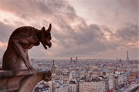 A gargoyle on Notre Dame de Paris cathedral looks over the city, Paris, France, Europe Stock Photo - Rights-Managed, Code: 841-06807825