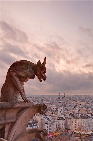 A gargoyle on Notre Dame de Paris cathedral looks over the city, Paris, France, Europe Stock Photo - Rights-Managed, Code: 841-06807826