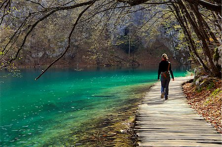 Visitor on wooden walkway path over Crystal Clear Waters of Plitvice Lakes National Park, UNESCO World Heritage Site, Plitvice, Croatia, Europe Stock Photo - Rights-Managed, Code: 841-06807962