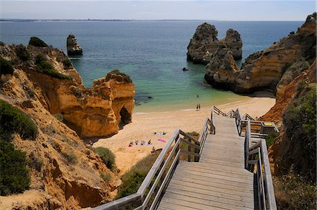 portugal - Wooden steps down to Praia do Camilo (Camel beach), Lagos, Algarve, Portugal, Europe Stock Photo - Rights-Managed, Code: 841-06808121