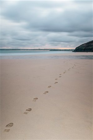 Footsteps in the sand, Carbis Bay beach, St. Ives, Cornwall, England, United Kingdom, Europe Stock Photo - Rights-Managed, Code: 841-07084490
