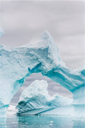 Huge arched iceberg near Petermann Island, western side of the Antarctic Peninsula, Southern Ocean, Polar Regions Stock Photo - Rights-Managed, Code: 841-07080940