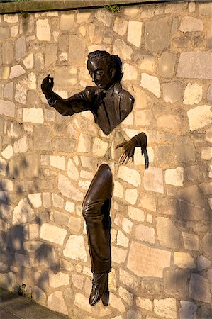 Sculpture of Le Passe Muraille (The Passer Through Walls)  by Jean Marais, Montmartre, Paris, France, Europe Stock Photo - Rights-Managed, Code: 841-07081211