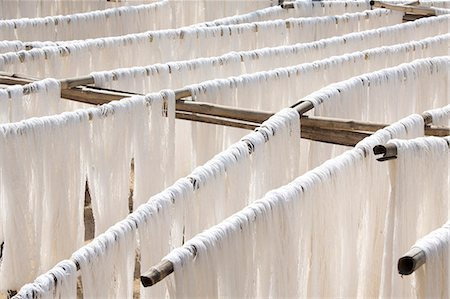 silky - White silk drying in the sun on bamboo racks, Amarapura, near Mandalay, Myanmar (Burma), Southeast Asia Stock Photo - Rights-Managed, Code: 841-07081624