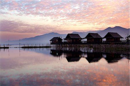 Golden Island Cottages at sunrise, tourist accommodation on Inle Lake, Myanmar (Burma) Stock Photo - Rights-Managed, Code: 841-07081655