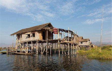 Houses built on stilts in the village of Nampan on the edge of Inle Lake, Myanmar (Burma), Southeast Asia Stock Photo - Rights-Managed, Code: 841-07081656
