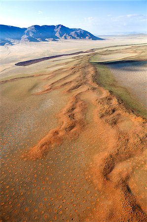 Aerial view from hot air balloon over magnificent desert landscape of sand dunes, mountains and Fairy Circles, Namib Rand game reserve Namib Naukluft Park, Namibia, Africa Stock Photo - Rights-Managed, Code: 841-07081739
