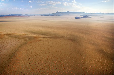 Aerial view from hot air balloon over magnificent desert landscape of sand dunes, mountains and Fairy Circles, Namib Rand game reserve Namib Naukluft Park, Namibia, Africa Stock Photo - Rights-Managed, Code: 841-07081750