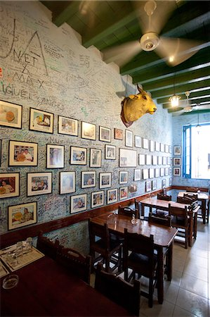 Interior of Bogadito del Medio, walls covered in graffiti, one of late author Ernest Hemingway's favourite bars, Havana Viejo, Havana, Cuba, West Indies, Central America Stock Photo - Rights-Managed, Code: 841-07081810