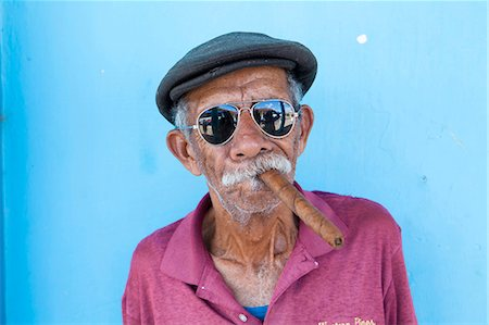 smoke - Old man wearing sunglasses and flat cap, smoking big Cuban cigar, Vinales, Pinar Del Rio Province, Cuba, West Indies, Central America Stock Photo - Rights-Managed, Code: 841-07081820