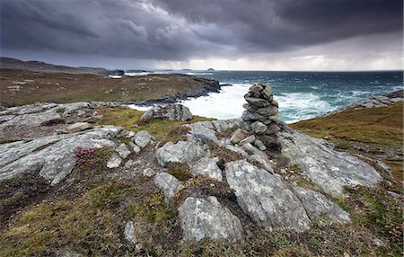 Dramatic rocky coastline above Gearrannan Blackhouse Village, near Carloway, Isle of Lewis, Outer Hebrides, Scotland, United Kingdom, Europe Stock Photo - Rights-Managed, Code: 841-07081853