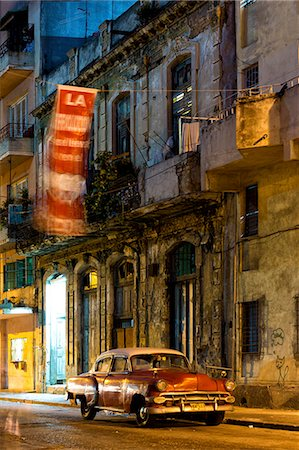 placing - Street scene at night lit by artificial lighting with vintage American car and fluttering revolutionary banner, Havana Centro, Havana, Cuba, West Indies, Central America Stock Photo - Rights-Managed, Code: 841-07081882