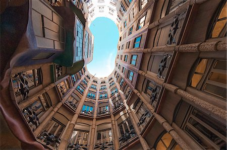 Interior fish eye view of La Pedrera (Casa Mila), an apartment block designed by Antonio Gaudi, UNESCO World Heritage Site, Passeig de Gracia, Barcelona, Catalunya, Spain, Europe Stock Photo - Rights-Managed, Code: 841-07082422