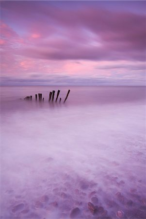 dreamy - Wooden posts at high tide on Porlock Beach, Exmoor, Somerset, England, United Kingdom, Europe Stock Photo - Rights-Managed, Code: 841-07082897