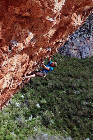 A climber scales cliffs near San Vito Lo Capo, northwest Sicily, Italy, Europe Stock Photo - Rights-Managed, Code: 841-07083071