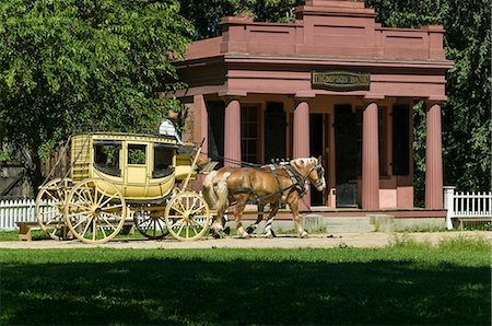 Horse drawn stagecoach at Old Sturbridge Village, a living history museum depicting early New England life from 1790 to 1840 in Sturbridge, Massachusetts, New England, United States of America, North America Stock Photo - Rights-Managed, Code: 841-07083089