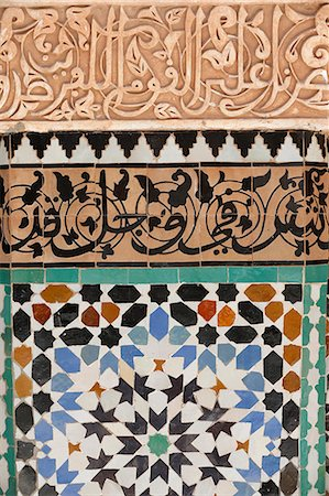decoration pattern - Detail of calligraphy and zellij in the patio, Ben Youssef Meders, the largest Medersa in Morocco, originally a religious school founded under Abou el Hassan, UNESCO World Heritage Site, Marrakech, Morocco, North Africa Stock Photo - Rights-Managed, Code: 841-07083297