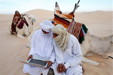 Bedouins using a laptop in the Sahara, Douz, Kebili, Tunisia, North Africa, Africa Stock Photo - Rights-Managed, Code: 841-07083358