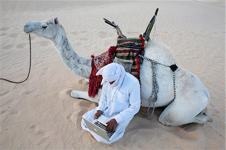 Bedouin using a laptop in the Sahara, Douz, Kebili, Tunisia, North Africa, Africa Stock Photo - Rights-Managed, Code: 841-07083359