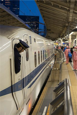 platform - Train personnel looking out of the window of the Shinkanzen bullet train in the Shinkanzen train station in Tokyo, Japan, Asia Stock Photo - Rights-Managed, Code: 841-07083639
