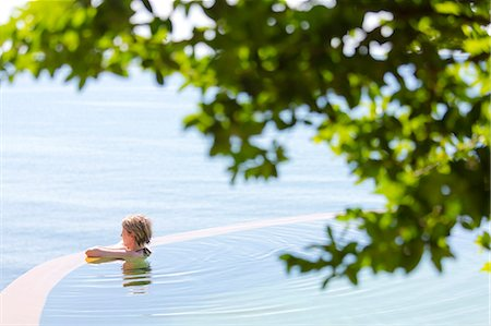 Woman in an infinity pool looking out to sea, Koh Samui, Thailand, Southeast Asia, Asia Stock Photo - Rights-Managed, Code: 841-07205181