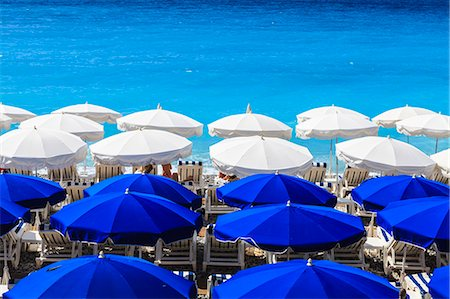 french (places and things) - Beach parasols, Nice, Alpes Maritimes, Provence, Cote d'Azur, French Riviera, France, Europe Stock Photo - Rights-Managed, Code: 841-07205922