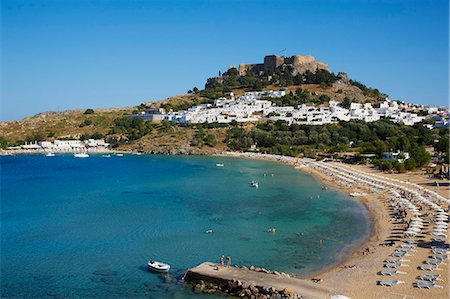 Acropolis and village, Lindos beach. Lindos, Rhodes, Dodecanese, Greek Islands, Greece, Europe Stock Photo - Rights-Managed, Code: 841-07206312