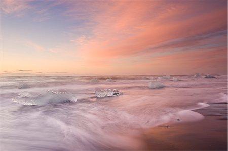 Icebergs on Beach, Jokulsarlon, Iceland, Polar Regions Stock Photo - Rights-Managed, Code: 841-07206420