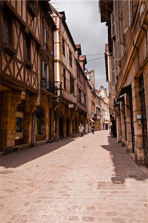 A narrow street with half timbered houses in the old city of Dijon, Burgundy, France, Europe Stock Photo - Rights-Managed, Code: 841-07206478