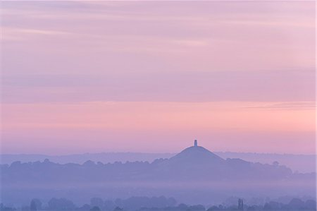 Glastonbury Tor rising surrounded by mist at dawn in summer, Somerset, England, United Kingdom, Europe Stock Photo - Rights-Managed, Code: 841-07355209