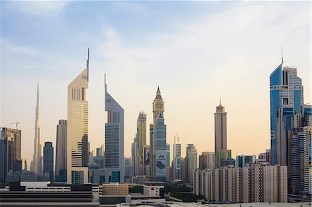 placing - Dubai cityscape with Burj Khalifa and Emirates Towers, Dubai, United Arab Emirates, Middle East Stock Photo - Rights-Managed, Code: 841-07355221