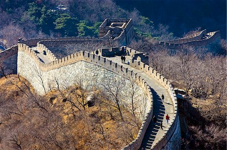 The ancient Great Wall of China snaking through mountains at Mutianyu, north of Beijing (formerly Peking) Stock Photo - Rights-Managed, Code: 841-07457214