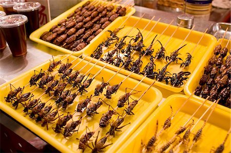 food stalls - Deep fried grasshoppers, silkworms and scorpions for sale in the Night Market, Wangfujing Street, Beijing, China Stock Photo - Rights-Managed, Code: 841-07457244