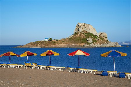 Beach on Kefalos Bay looking out to Kastri Island, Kos, Dodecanese, Greek Islands, Greece, Europe Stock Photo - Rights-Managed, Code: 841-07457713