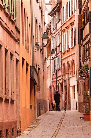 A man walks through La Petite France, Grande Ile, UNESCO World Heritage Site, Strasbourg, Bas-Rhin, Alsace, France, Europe Stock Photo - Rights-Managed, Code: 841-07524069