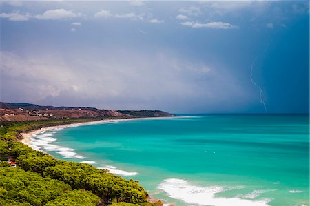 Thunder and lightning storm over Capo Bianco Beach and the Mediterranean Sea in the Province of Agrigento, Sicily, Italy, Europe Stock Photo - Rights-Managed, Code: 841-07523211