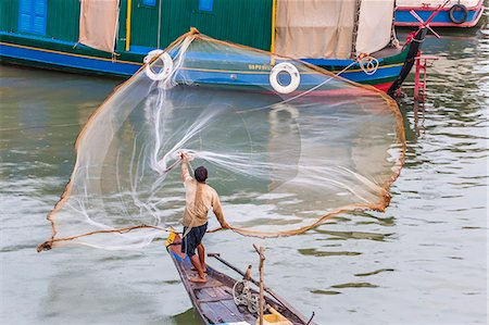 fishing - Fisherman casting net along the Mekong River in the capital city of Phnom Penh, Cambodia, Indochina, Southeast Asia, Asia Stock Photo - Rights-Managed, Code: 841-07523332