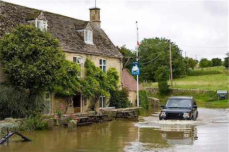 Four wheel drive car drives through flooded road in Swinbrook, Oxfordshire, England, United Kingdom Stock Photo - Rights-Managed, Code: 841-07523520