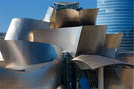 Architect Frank Gehry's Guggenheim Museum futuristic design in titanium and glass and Iberdrola Tower behind at Bilbao, Spain Stock Photo - Rights-Managed, Code: 841-07523719
