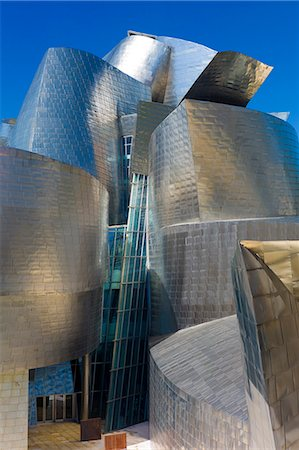 Architect Frank Gehry's Guggenheim Museum futuristic architectural design in titanium and glass at Bilbao, Basque country, Spain Stock Photo - Rights-Managed, Code: 841-07523720