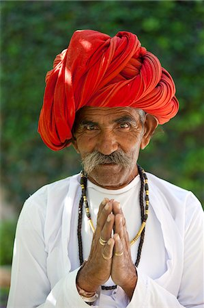 Traditional Namaste greeting from Indian man with traditional Rajasthani turban in village in Rajasthan, India Stock Photo - Rights-Managed, Code: 841-07540468
