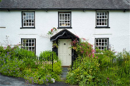 quaint house - Quaint lakeland cottage with studded front door and Welcome sign, at Troutbeck in the Lake District National Park, Cumbria, UK Stock Photo - Rights-Managed, Code: 841-07540543