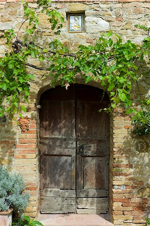 Ancient doorway and religious painting at Il Rigo agritourismo hotel and farmhouse, San Quirico d'Orcia, in Val D'Orcia area Tuscany, Italy Stock Photo - Rights-Managed, Code: 841-07540596