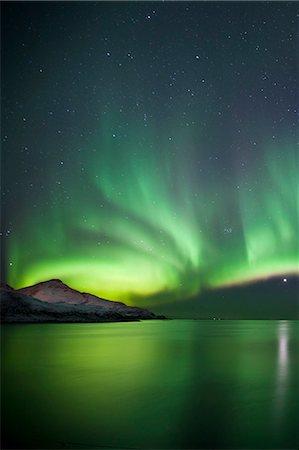 The Aurora Borealis spectacular Northern Lights and Venus star at Grotfjord, Kvaloya island, Tromso in the Arctic Circle, Northern Norway Stock Photo - Rights-Managed, Code: 841-07540688
