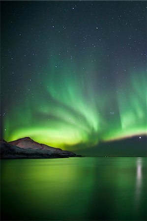 dreamy - The Aurora Borealis spectacular Northern Lights and Venus star at Grotfjord, Kvaloya island, Tromso in the Arctic Circle, Northern Norway Stock Photo - Rights-Managed, Code: 841-07540688