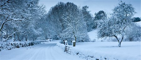 panoramic winter scene - Traditional snow scene in a country lane in The Cotswolds, Swinbrook, Oxfordshire, United Kingdom Stock Photo - Rights-Managed, Code: 841-07540740